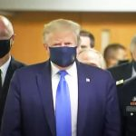 In a first, Trump dons anti-COVID-19 mask