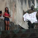 A PICTURE AND ITS STORY-The despair of a Rio widow, in a city struggling with violence
