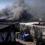 Thousands homeless after fire guts migrant camp on Greek island