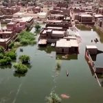 Made homeless by record floods, tens of thousands of Sudanese wait for aid