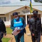 Rwandan deported from U.S. denies charges