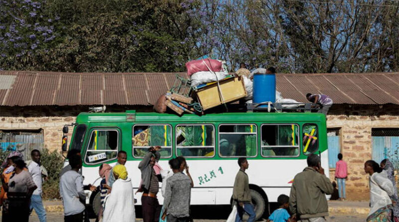 A bus carrying displaced people