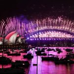 Fireworks explode over empty streets as 2020 slinks away into history