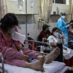 India's COVID-19 daily cases stay near record, another state imposes lockdown