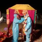 Indian wedding takes on otherworldly feel after bride tests positive for COVID-19