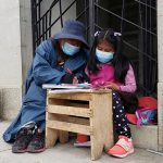 Scared of school? Bolivian girl takes her virtual classes in a cemetery