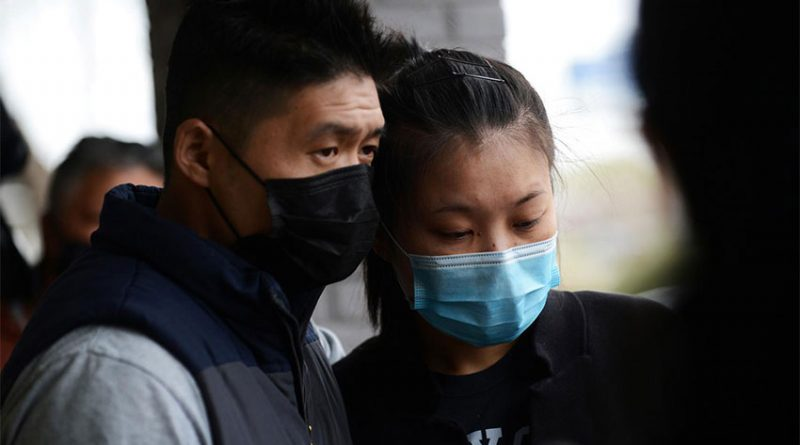 Kevin Chen consoles his fiancee Jami Webb