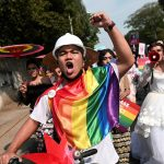 In Myanmar, LGBT+ people join anti-coup protests with rainbow flags