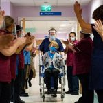 In COVID-19 milestone for West, Britain starts mass vaccination