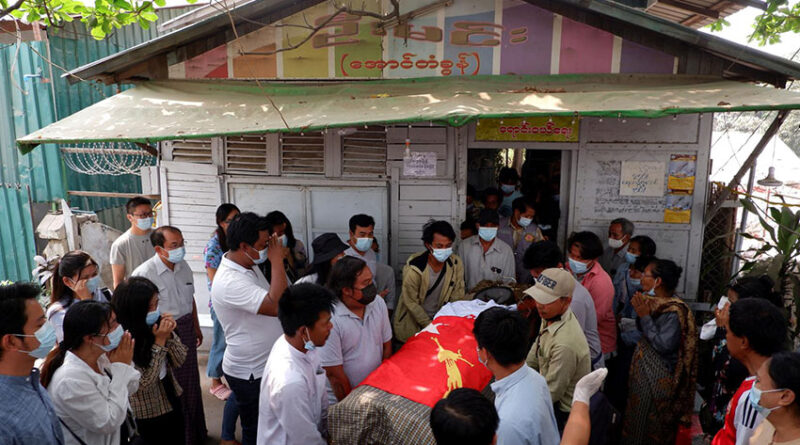 People attend the funeral of Kyaw Win Maung