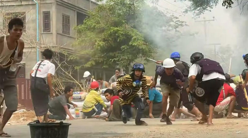 Myanmar protesters take cover during clashes with security forces