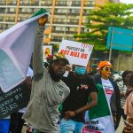 Lagos imposes 24-hour curfew amid protests against Nigeria's police
