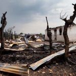 Suspected Islamists kill 18, torch church in east Congo