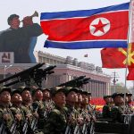 North Korea holds rare predawn military parade