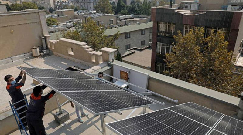 Technicians install solar panels on a residential rooftop