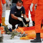 Indonesia locates black boxes of crashed jet as body parts recovered