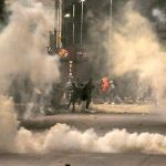 Tunisian police fire tear gas on protesters in southern city
