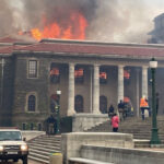 Battle to contain Cape Town fire, man arrested