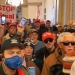 Guns and teargas as Trump supporters storm Capitol Hill